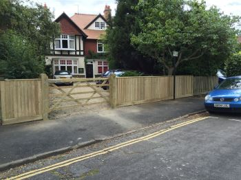 Close board fencing & field gate