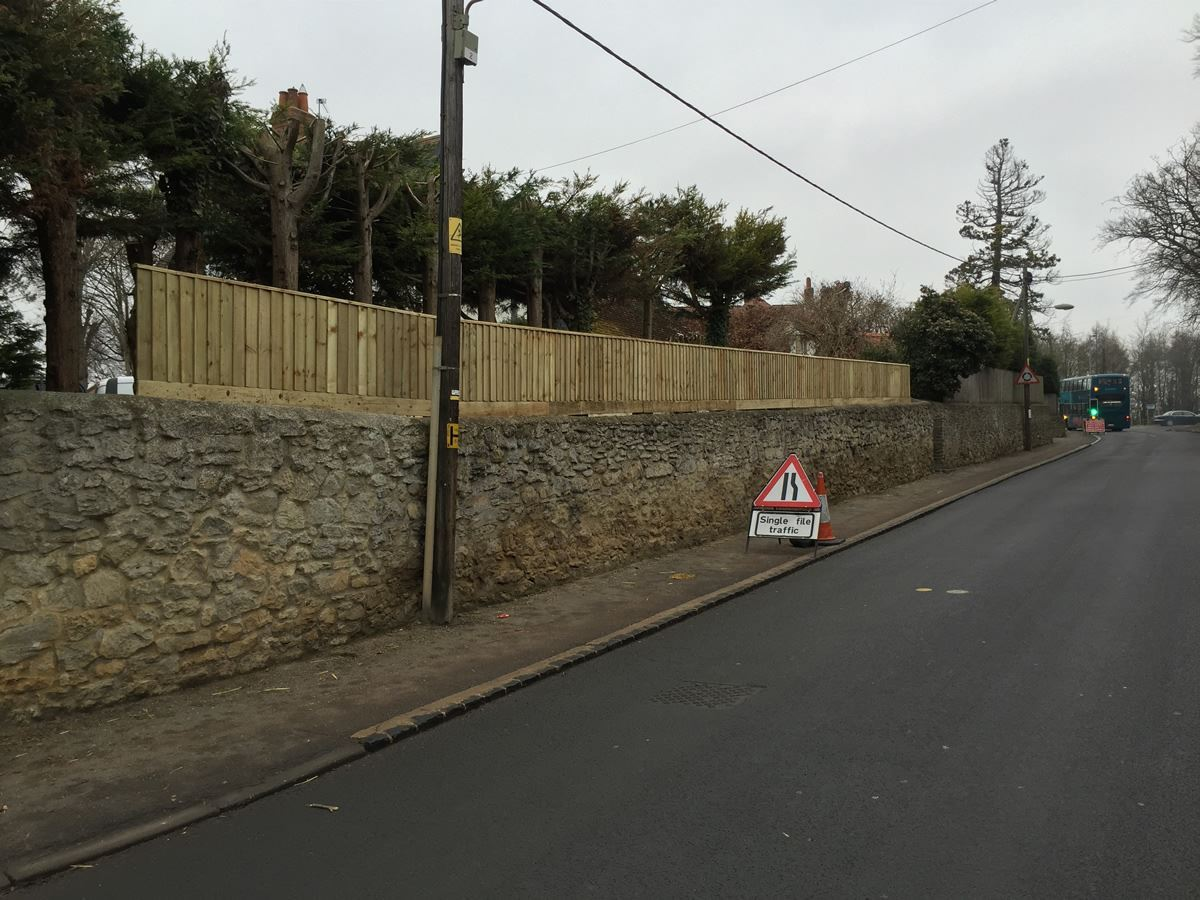 Close board fencing above wall