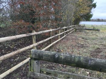 Round UC4 post and half round rail fencing