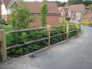 Cleft chestnut post & rail fencing with oak posts