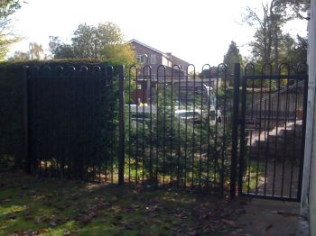 Steel bow top railings & gate