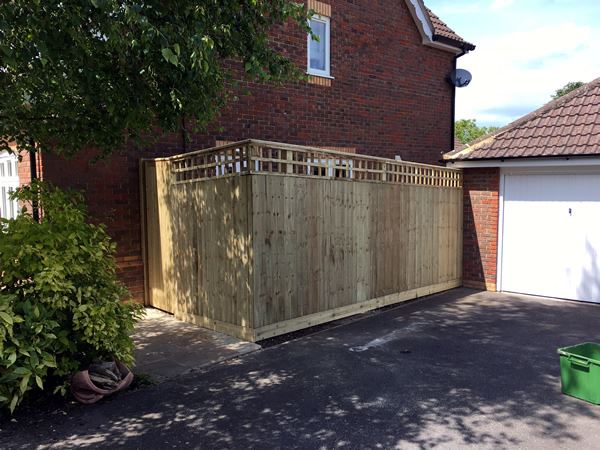 Oxford house with close board fencing