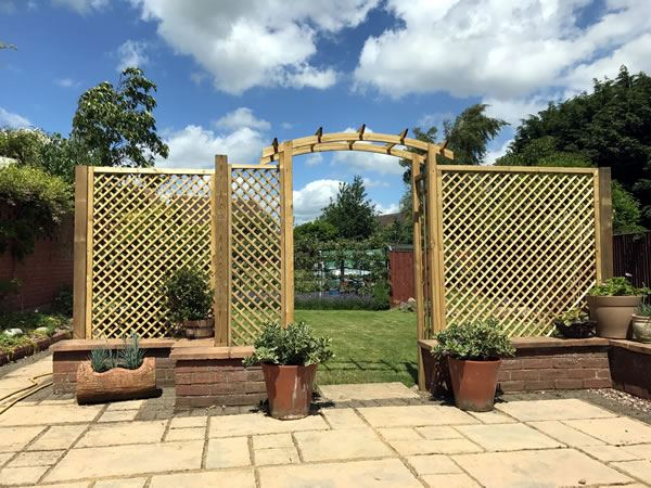 Decorative archway and trellis in Thame garden